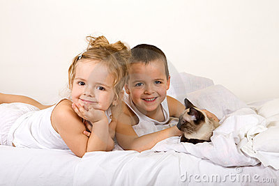 Happy kids with their kitten