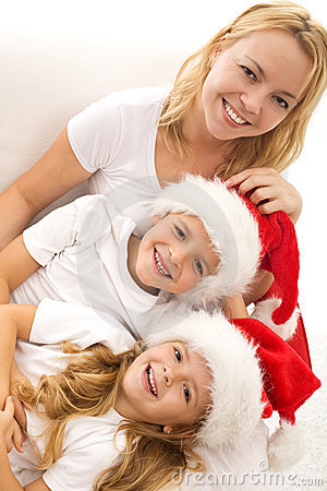 Happy kids and woman relaxing at christmas time