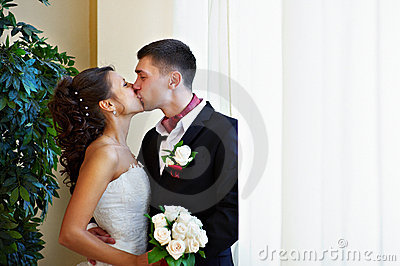 Happy kiss bride and groom
