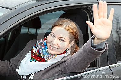 Happy lady a driver