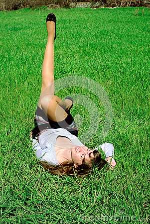 Happy lady on grass stretching leg (2)