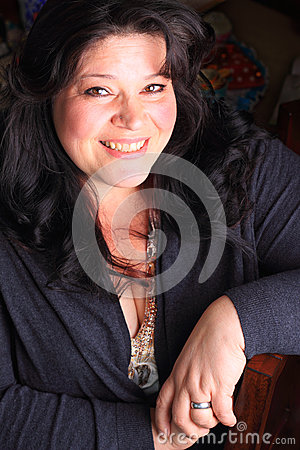 happy lady portrait pretty large dark haired smile cleavage 40552427