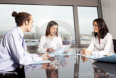 Happy latin woman at business meeting