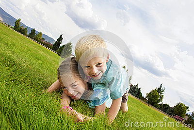 Happy laughing Kids Playing Outdoors