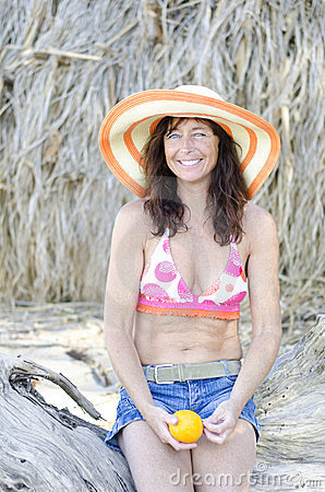 Happy laughing mature woman on beach