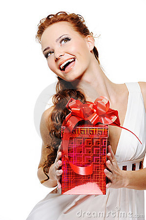 Happy laughing woman holding the red present