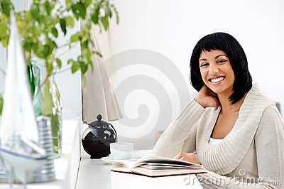 Happy leisure woman with book