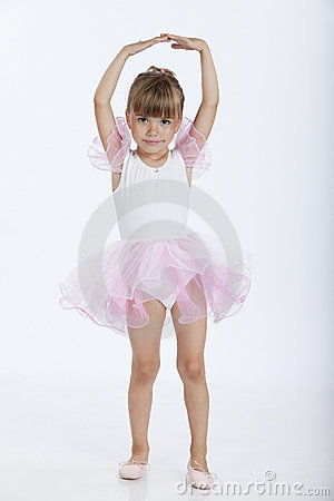 Happy little ballerina in ballet position