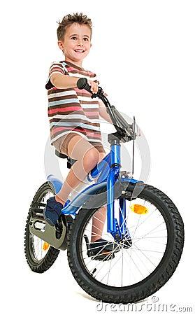 Happy little boy on bike
