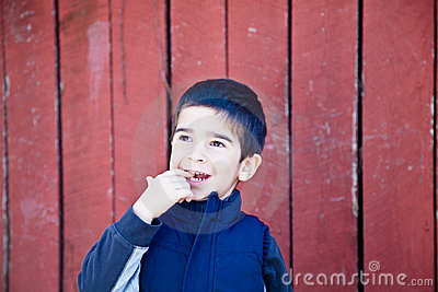 Happy Little Boy with a Finger in his Mouth
