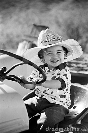 Happy Little Boy Playing on Tractor