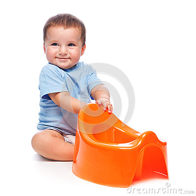Happy little boy with potty