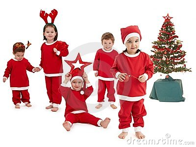 Happy little children in Santa costume