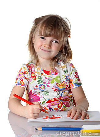Happy little girl drawing a picture