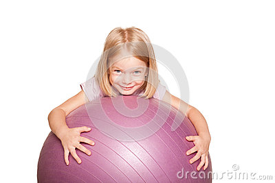Happy little girl with fitness ball.