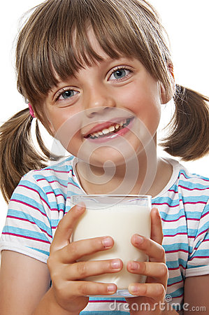 Happy little girl with glass of milk
