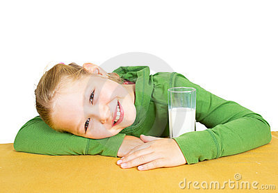 Happy little girl with a glass of milk, isolated