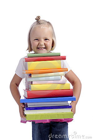 Happy little girl with heavy stack of books