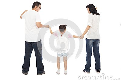 Happy little girl hold parents hands together Stock Photo