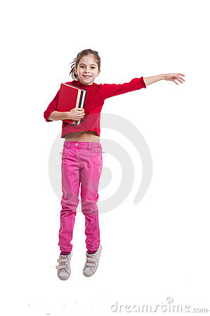 Happy little  girl holding books jumping