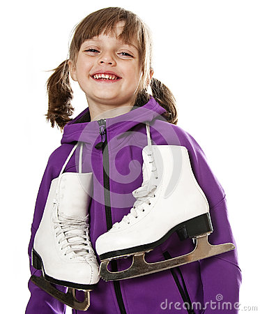 Happy little girl holding ice skates