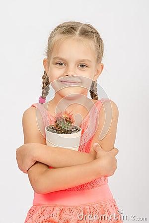 Free Happy Little Girl Hug Pot Of Cactus Royalty Free Stock Photography - 58105237