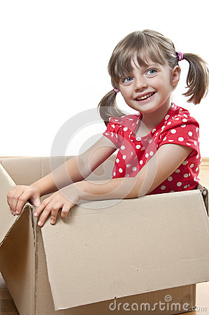 Happy little girl inside a paper box