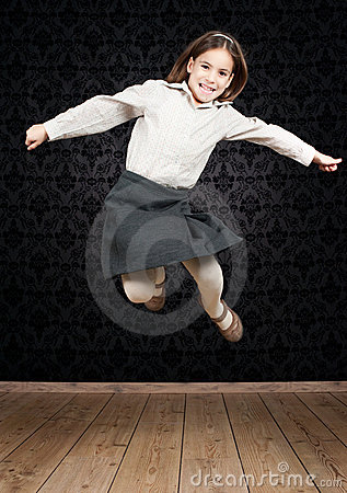 Happy little girl jumping