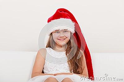 Happy little girl kid in santa hat christmas stock photo image