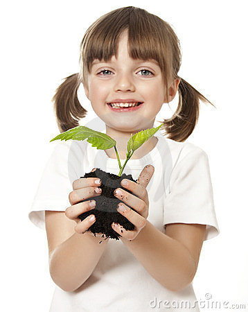 Happy little girl with plant
