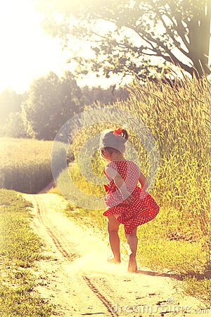 Free Happy Little Girl Playing On Meadow, Sunset, Summertime Stock Photo - 51221370