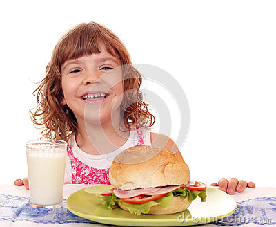 Happy little girl with sandwich