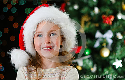 Happy little girl in santa s hat