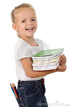 Happy little girl with school books