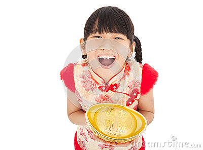 Happy little girl showing  gold
