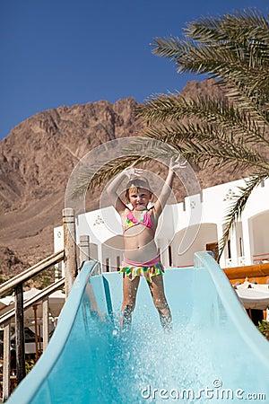 Happy little girl on slide