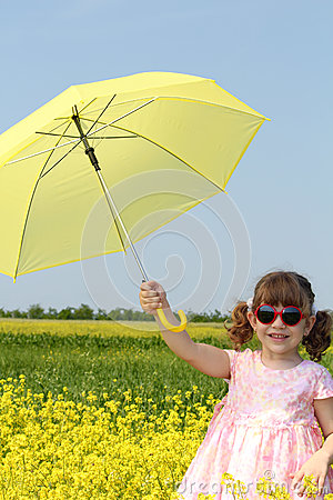 Happy little girl with umbrella