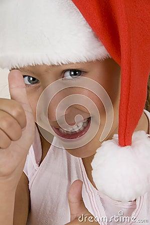 Happy little girl wearing christmas hat