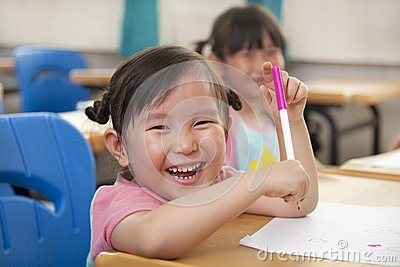 Happy little girls drawing picture