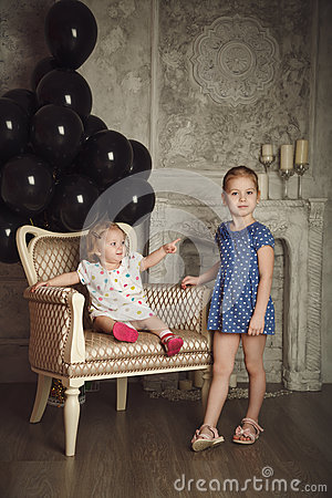 Free Happy Little Sisters With Black Balloons. Stock Photos - 68445633
