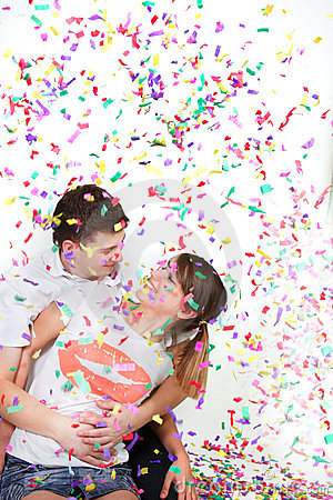 Happy loving couple in confetti