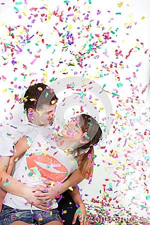 Happy loving couple in confetti