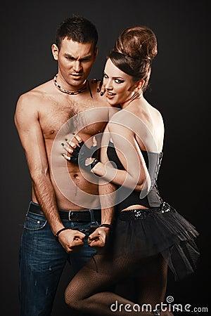 Happy loving couple. Dark background.