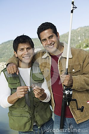 Happy Male Friends Fishing Together