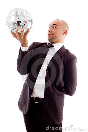 Happy male holding shining disco ball