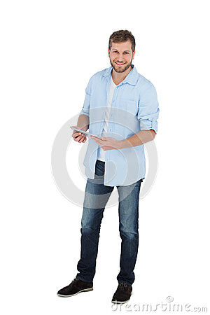 Happy male model using his tablet pc
