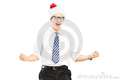Happy male with santa hat gesturing happiness