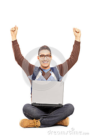 Happy male student sitting with a laptop and gesturing happiness