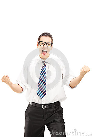 Happy male with tie gesturing happiness and looking at camera
