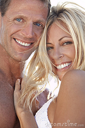 Free & Happy Man And Woman Couple At The Beach Stock Photo - 14645710